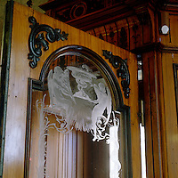 The classical medical symbol of a snake can be found etched on the glass door of a 19th century pharmacy in Stockholm