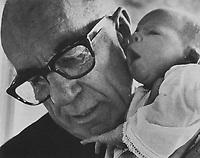 Benjamin Spock, American pediatrician (with his first granddaughter, Susannah)
