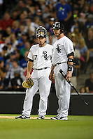 Chicago White Sox catcher Adrian Nieto (17) and Tyler Flowers (21) wait for a video review during a game against the Toronto Blue Jays on August 15, 2014 at U.S. Cellular Field in Chicago, Illinois.  Chicago defeated Toronto 11-5.  (Mike Janes/Four Seam Images)