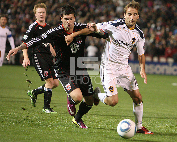 Santino Quaranta (25) of D.C. United tackles Mike Magee (18) of the Los Angeles Galaxy during an MLS match at RFK Stadium, on April 9 2011, in Washington D.C.The game ended in a 1-1 tie.