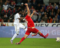 Pictured L-R: Marvin Emnes  of Swansea scores, making the score 3-0 to his team, Keith Lowe of York City fails to stop him Tuesday 25 August 2015<br /> Re: Capital One Cup, Round Two, Swansea City v York City at the Liberty Stadium, Swansea, UK.