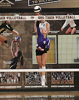 Kennedy Phelan serves against Bentonville on Thursday, Oct.  7, 2021, during play at Tiger Arena in Bentonville. Visit nwaonline.com/211008Daily/ for today's photo gallery.<br /> (Special to the NWA Democrat-Gazette/David Beach)