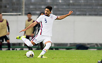 GUADALAJARA, MEXICO - MARCH 24: Mauricio Pineda #5 of the United States sends a ball downfield during a game between Mexico and USMNT U-23 at Estadio Jalisco on March 24, 2021 in Guadalajara, Mexico.