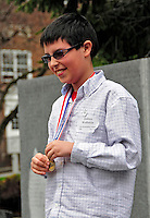 17 April 2010:  Joshua Wolfstein, a student from Eve Dubois' 6th Grade Class at Shelburne's Renaissance School smiles after winning a Gold Medal at the 2010 Vermont State Science and Mathematics Fair held at Norwich University, in Northfield, Vermont. Josh also received a cash prize from NRG for his project comparing wood and grass pellet renewable energy fuels. Mandatory Photo Credit: Ed Wolfstein Photo