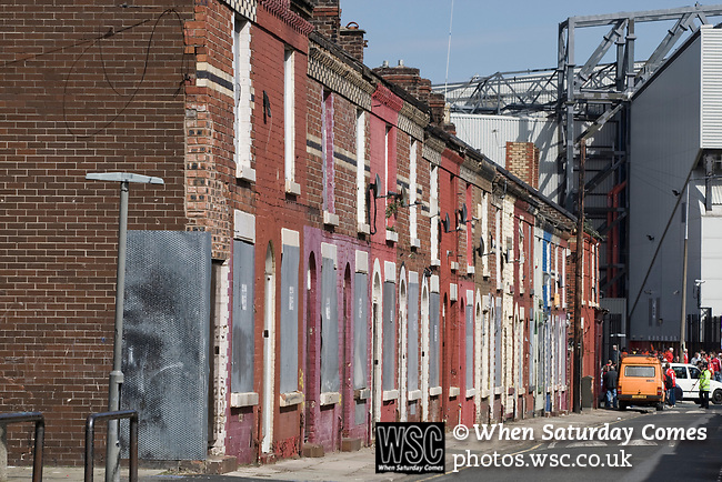 Boarded up and derelict houses in a street adjacent to Anfield, home of Liverpool football club, pictured before the club took on Fulham in a Premier League match during the 2009-10 season. The club was one of the most successful and best supported teams in England and which won many domestic and European trophies. The most-famous part of the stadium was the Kop, where the Liverpool fans sat during games. Photo by Colin McPherson
