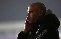 Dejected Grimsby Town manager Marcus Bignot puts his head in his hand during the Sky Bet League Two match between Newport County and Grimsby Town at Rodney Parade, Newport, Wales, UK. Tuesday 14 February 2017