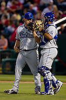 Rob Scahill (34) of the Tulsa Drillers talks with Wilin Rosario (20) during a game against the Springfield Cardinals on April 29, 2011 at Hammons Field in Springfield, Missouri.  Photo By David Welker/Four Seam Images.