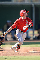 Los Angeles Angels second baseman Kody Eaves (21) hits a grand slam home run during an Instructional League game against the Milwaukee Brewers on October 11, 2013 at Tempe Diablo Stadium Complex in Tempe, Arizona.  (Mike Janes/Four Seam Images)
