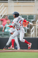 Herlis Rodriguez (33) of the Lakewood BlueClaws follows through on his swing against the Kannapolis Intimidators at Intimidators Stadium on July 14, 2015 in Kannapolis, North Carolina.  The Intimidators defeated the BlueClaws 8-2.  (Brian Westerholt/Four Seam Images)