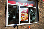 © Joel Goodman - 07973 332324 - all rights reserved . 17/07/2010 . Dudley , UK . The windows of a branch of KFC are smashed as the English Defence League ( EDL ) hold a demonstration in Dudley . Photo credit : Joel Goodman
