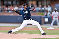 Asheville Tourists starting pitcher Antonio Santos (10) delivers a pitch during a game against the Greenville Drive at McCormick Field on April 13, 2017 in Asheville, North Carolina. The Tourists defeated the Drive 3-1. (Tony Farlow/Four Seam Images)