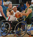 Richard Peter (7) of Vancouver defends against Tristan Knowles of Australia in the gold medal game in men's wheelchair basketball action in Beijing during the Paralympic Games, Tuesday, Sept., 16, 2008.    Photo by Mike Ridewood/CPC