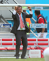 Costa Rica coach Jorge Luis Pinto celebrates victory over Italy