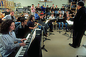 """MR / Schenectady, NY.School of Fine Arts at Schenectady High School (urban public high school) jazz band rehearsal..Students are participating in an artist-in-residency program; conductor is Rufus Reid of jazz group Tana-Reid; residency is multi-funded (by school district and area arts groups, including NYSCA)..""""House plan"""" organization of large urban school allows students to be grouped by interest into smaller, more manageable """"houses""""..MR: SHS-9-lst.Scan from slide film, PN28088.©Ellen B. Senisi"""