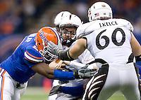 01 January 2010:  Carlos Dunlap of Florida sacks Tony Pike of Cincinnati during the game during Sugar Bowl at the SuperDome in New Orleans, Louisiana.  Florida defeated Cincinnati, 51-24.