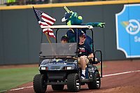 """Columbia Fireflies mascot """"Mason"""" points at fans as he rides around the warning track in a golf cart between innings of the game against the Rome Braves on Monday, July 3, 2017, at Spirit Communications Park in Columbia, South Carolina. Columbia won, 1-0. (Tom Priddy/Four Seam Images)"""