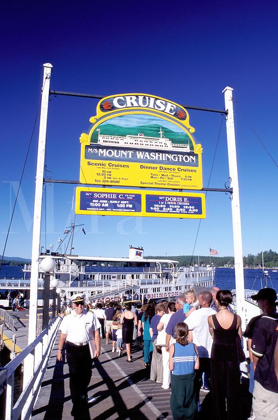 New Hampshire, Weirs Beach, NH, Passengers standing in line waiting to board the M.S. Mt. Washington Cruise Boat on Lake Winnipesaukee.