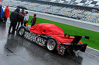 The rain is coming down hard during pre-race, #95 Crown Royal-NPN Racing BMW/Riley