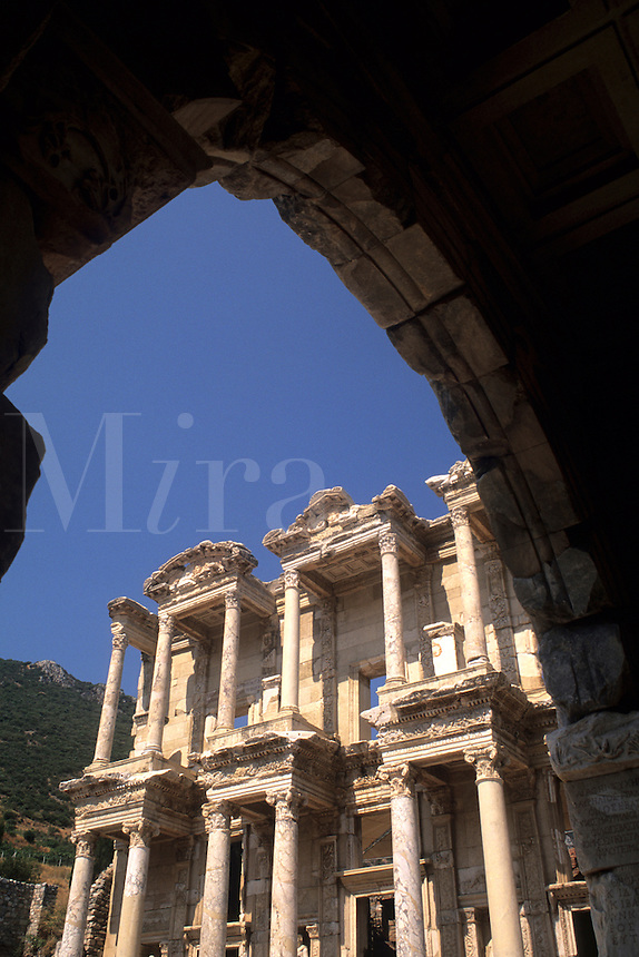 Historical famous ruins of library Bibliotheque of Celsus most famosu and perfect ruins in the world at Ephesus Turkey thru arch