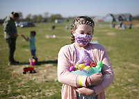 Mary Thicksten, 9, of Bentonville carries Easter eggs she collected, Friday, April 2, 2021 at 10107 Andy Buck Road in Pea Ridge. No Limit Pediatric Therapies held its first special needs friendly Easter egg hunt in celebration of World Autism Awareness Day. Check out nwaonline.com/210403Daily/ for today's photo gallery. <br /> (NWA Democrat-Gazette/Charlie Kaijo)