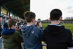 Three young Darlington fans recording the match on their phones. Darlington 1883 v Southport, National League North, 16th February 2019. The reborn Darlington 1883 share a ground with the town's Rugby Union club. <br />