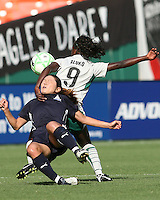 Homare Sawa #10 of the Washington Freedom is throttled by Eniola Aluko #9 of St. Louis Athletica during a WPS match at RFK Stadium on July 18 2009, in Washington D.C. Freedom won the match 1-0.
