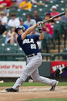 New Orleans Zephyrs third baseman Ben Lasater #20 follows through on his swing against the Round Rock Express in the Pacific Coast League baseball game on April 21, 2013 at the Dell Diamond in Round Rock, Texas. Round Rock defeated New Orleans 7-1. (Andrew Woolley/Four Seam Images).