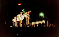 """""""Brandenburg Gate"""" by Art Harman. Two armed East German guards atop the wall. November, 1989"""