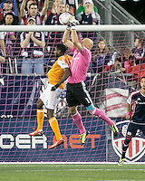 New England Revolution goalkeeper Matt Reis (1) catches a ball off of a corner kick as Houston Dynamo midfielder Warren Creavalle (5) leaps to head it in.  The New England Revolution played to a 1-1 draw against the Houston Dynamo during a Major League Soccer (MLS) match at Gillette Stadium in Foxborough, MA on September 28, 2013.