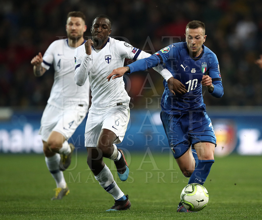 Football: Euro 2020 Group J qualifying football match Italy vs Finland at the Friuli Stadium in Udine on march  23, 2019<br /> Italy's Federico Bernardeschi (r) in action with Finland's Glen Kamara (l) during the Euro 2020 qualifying football match between Italy and Finland at the Friuli Stadium in Udine, on march 23, 019<br /> UPDATE IMAGES PRESS/Isabella Bonotto