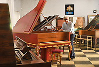 BNPS.co.uk (01202) 558833<br /> Pic: ZacharyCulpin/BNPS<br /> <br /> Pictured: David with the Chinoiserie Pleyel piano which is on offer for £60,000<br /> <br /> A remarkable collection of rare pianos belonging to the Queen's personal restorer and conservator has emerged for sale for £250,000.<br /> <br /> David Winston is parting with 26 pianos he has amassed over the past 30 years dating from the 18th century to the present day.<br /> <br /> Mr Winston, who was awarded the Royal Warrant in 2012, is regarded as one of the foremost experts in his field and has restored pianos owned and played by Beethoven, Chopin and Liszt.<br /> <br /> His collection includes a 1925 Pleyel grand piano fitted with an original 'Auto Pleyela' self-playing mechanism in a spectacular Chinoiserie Louis XV case valued at 60,000.