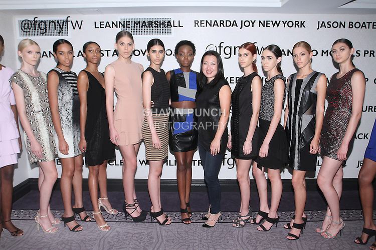 Fashion designer Claire Henkel (5th from right) poses with models, after her Urban Sewn Spring Summer 2016 collection fashion show, at the Fashion Gallery NYFW Designer's Collective Spring Summer 2016 show, during New York Fashion Week.