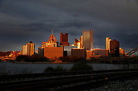 The sun sets over the downtown Pittsburgh skyline on Thursday April 9, 2020 in Pittsburgh, Pennsylvania. (Photo by Jared Wickerham/Pittsburgh City Paper)