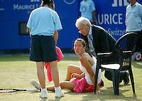 22-6-06,Netherlands, Rosmalen,Tennis, Ordina Open, quarter final, Jelena Jankovic de tegenstandster van Krajicek gaat tegen de grond en moet de partij opgeven