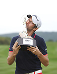 Frenchman Gregory Bourdy celebrates with the trophy after winning the ISPS Handa Wales Open 2013 at the Celtic Manor Resort.<br /> <br /> 01.09.13<br /> <br /> ©Steve Pope-Sportingwales