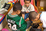 preschool 4-5 year olds pretend play group of boys playing dressup horizontal