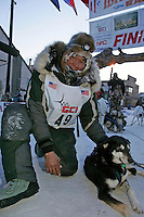 Thursday  March 15, 2007   ---- Nome, Alaska.   Louis Nelson Sr.  is shown in Nome posing with his lead dog after finishing the Iditarod in 24th place.