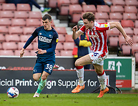 20th March 2021; Bet365 Stadium, Stoke, Staffordshire, England; English Football League Championship Football, Stoke City versus Derby County; Jason Knight of Derby County and Harry Souttar of Stoke City chase a loose ball