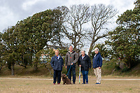 BNPS.co.uk (01202) 558833. <br /> Pic: CorinMesser/BNPS<br /> <br /> Pictured: Councillor Ann Stribley, John Challinor, chairman of the Parkstone Bay Residents Association with Buddy the dog, Eunice Marsden and Liz Bearcroft stand in front of the two dead oak trees. <br /> <br /> Police have launched an investigation into allegations a wealthy homeowner has killed two 'magnificent' oak trees because they blocked their sea views.<br /> <br /> The 70ft tall mature specimens have had holes drilled into their trunks and poison poured inside in a 'disgraceful' act of sabotage. <br /> <br /> The two trees stand on the edge of a recreation ground between Poole Harbour, Dorset, and a cluster of luxury homes that sell for between £2m to £3m.