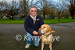 Tim Moynihan with Terry the dog enjoying a walk in the Tralee town park on Friday.