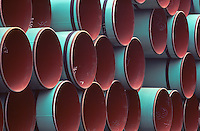 Heavy duty lined steel pipes stockpiled for main oil/gas transmission line.