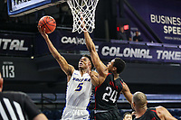 Washington, DC - March 10, 2020: Hofstra Pride guard Eli Pemberton (5) makes a layup during the CAA championship game between Hofstra and Northeastern at  Entertainment and Sports Arena in Washington, DC.   (Photo by Elliott Brown/Media Images International)