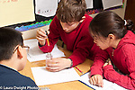 Education Grade 5 group of students at work on science experiment