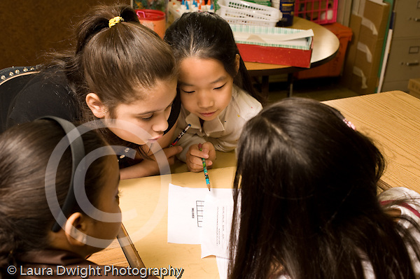 Education Elementary school Grade  4 small group of girls working on graph project in science special horizontal