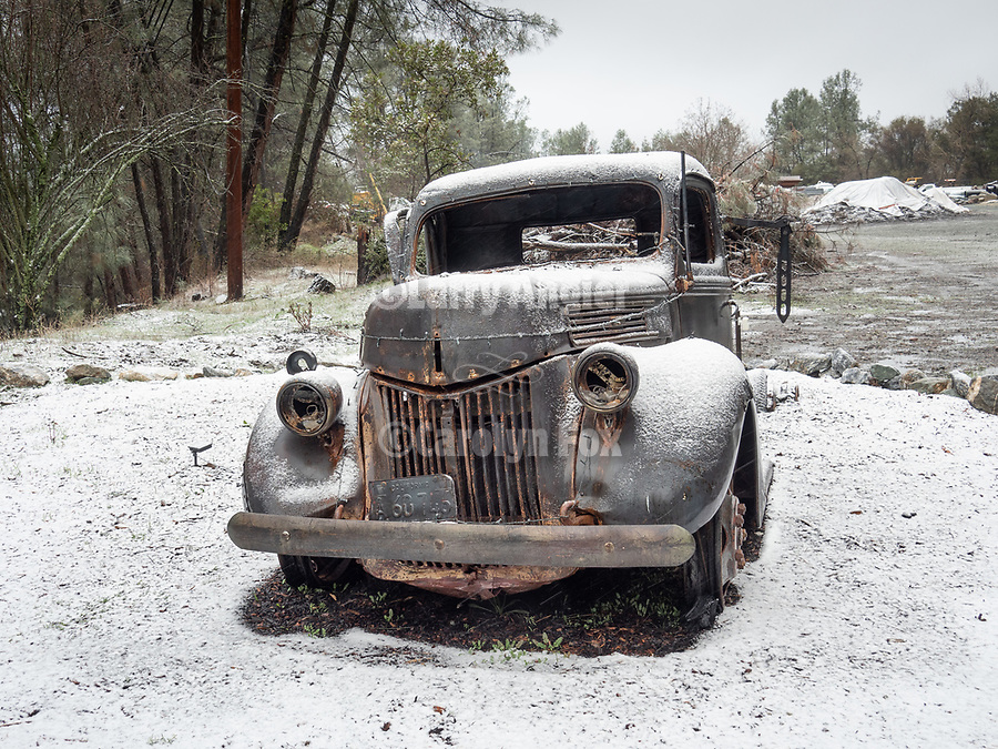 An old truck by the road, during a snow storm, Sutter Creek, Calif.