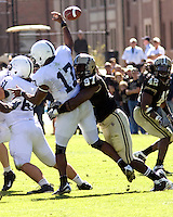 October 03, 2008: Purdue defensive end Gerald Gooden (97) puts a hit on Penn State quarterback Daryll Clark. The Penn State Nittany Lions defeated the Purdue Boilermakers 20-06 on October 03, 2008 at Ross-Ade Stadium, West Lafayette, Indiana.