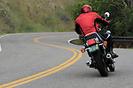 Male motorcyclist riding on Lookout Mountain Road west of Denver, Colorado, USA .  John leads private photo tours in Boulder and throughout Colorado. Year-round.