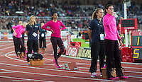 22 AUG 2013 - STOCKHOLM, SWE - Zuzana Hejnova (right) of the Czech Republic takes a drink of water as she waits for the start of the women's 400m hurdles during the DN Galen meet of the 2013 Diamond League at the Stockholm Olympic Stadium in Stockholm, Sweden (PHOTO COPYRIGHT © 2013 NIGEL FARROW, ALL RIGHTS RESERVED)