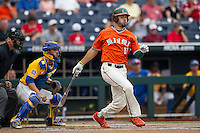 Miami Hurricanes outfielder Willie Abreu (13) follows through on his swing against the UC Santa Barbara Gauchos in Game 5 of the NCAA College World Series on June 20, 2016 at TD Ameritrade Park in Omaha, Nebraska. UC Santa Barbara defeated Miami  5-3. (Andrew Woolley/Four Seam Images)