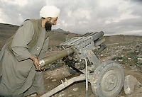 A Taleban charging a 12 field missile launcher in the direction of warlord Ahmad Shah Massoud force South of Kabul.